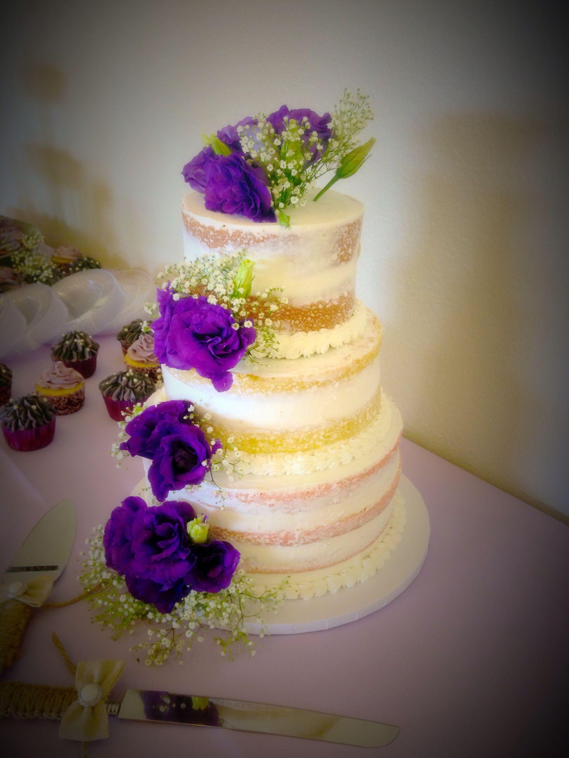 Naked wedding cake with fresh flowers #finishingtouchesbyliz #purple ...