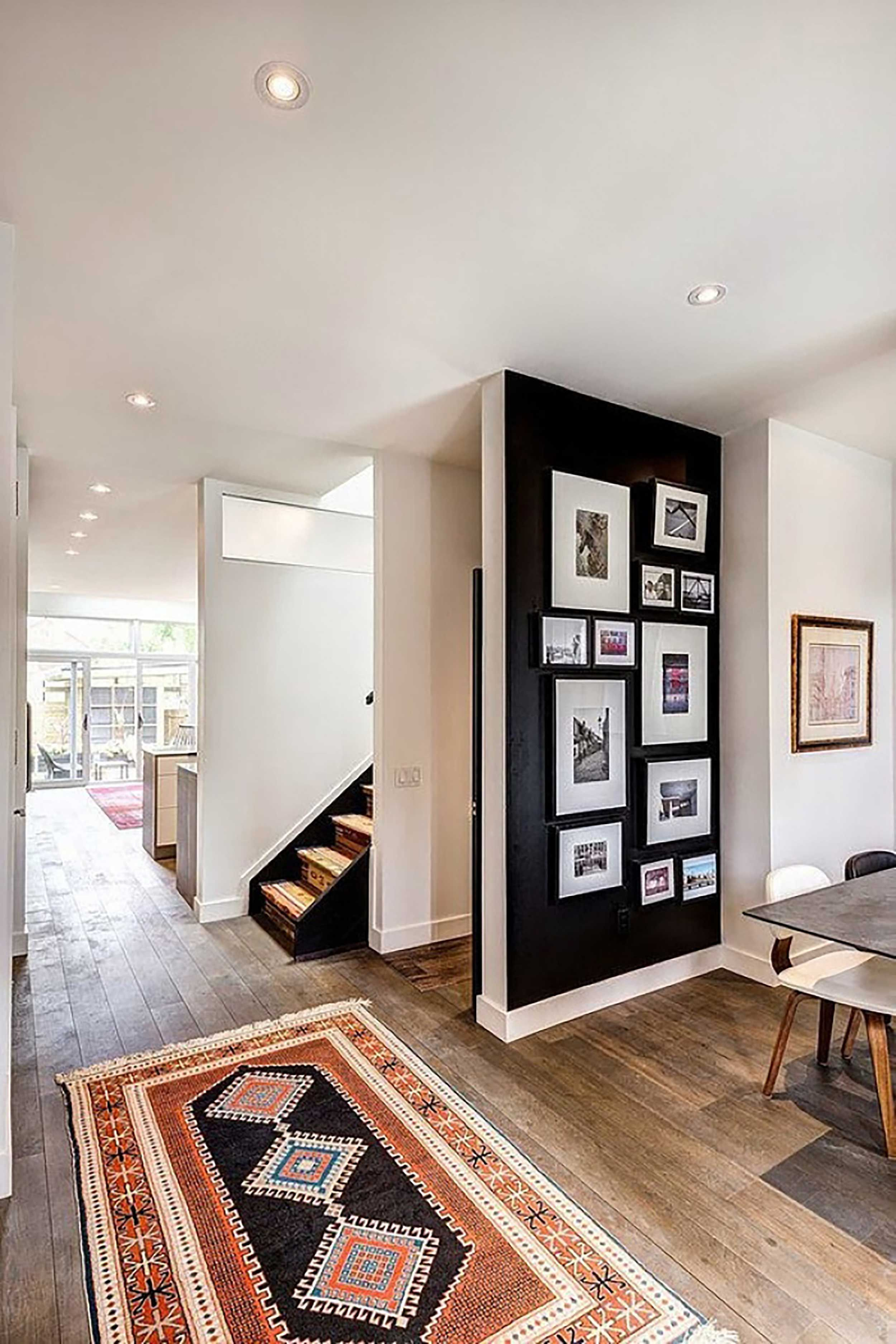 Accent Walls Are Cool Again Here S How To Get Them Right Black Dining Room Black Accent Walls Accent Wall
