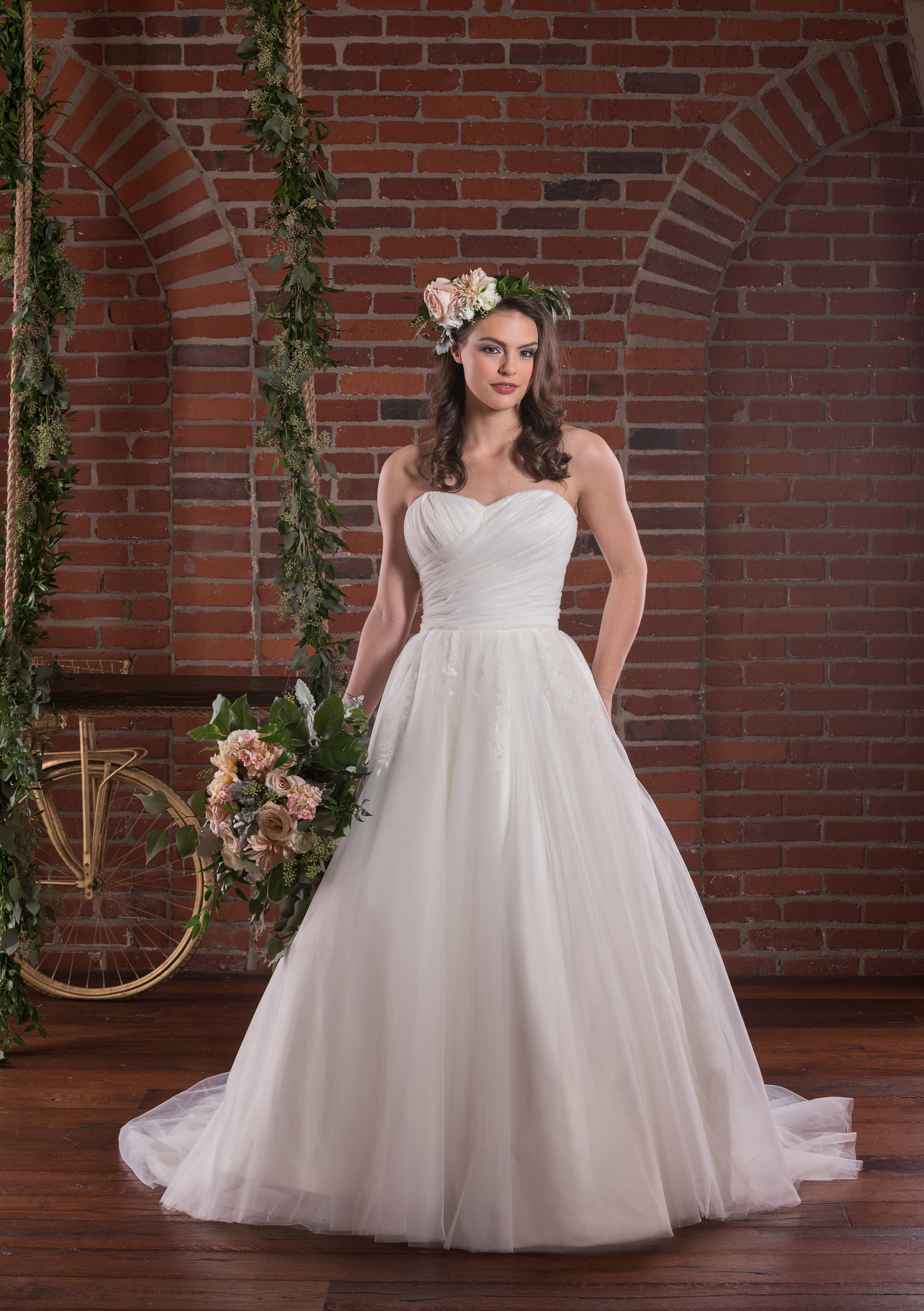 Soft rouched tulle on bodice over lace applique ball gown