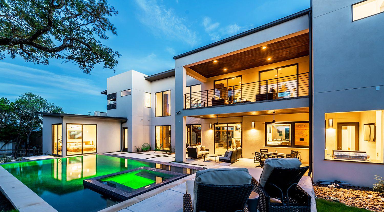 Custom l shaped infinity edge pool adam wilson custom homes luxury custom home builder pools custompools luxury