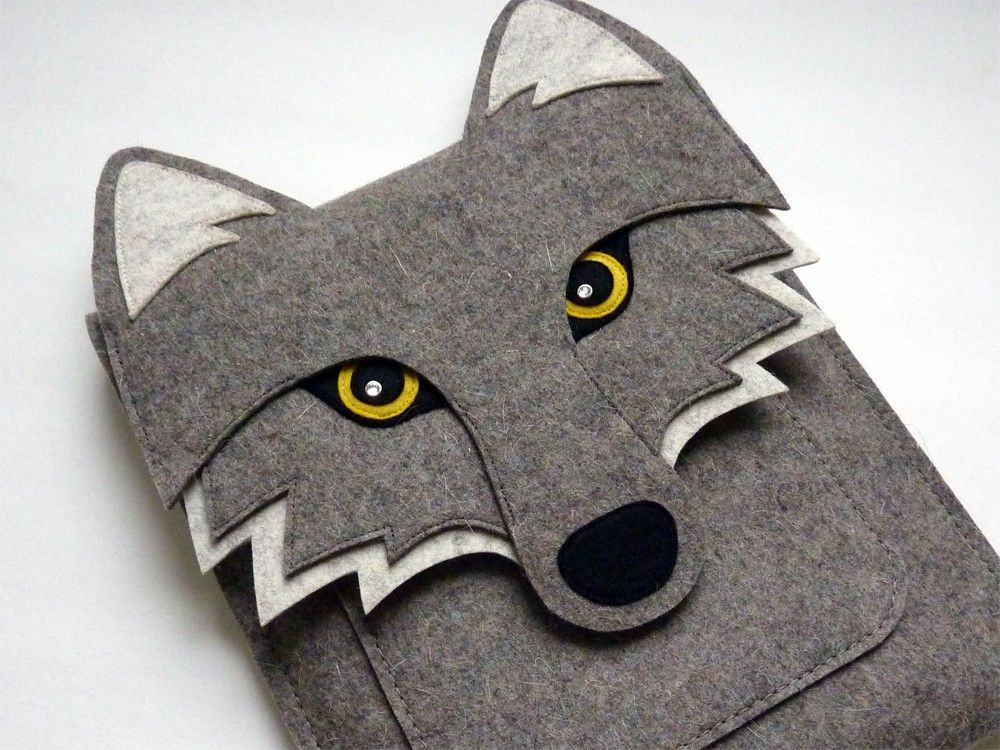 This wolf iPad sleeve fits the New iPad (3rd generation), iPad 2 and iPad 1. It is made with 100% wool design felt. The flap is attached with a metal button. Details are made with 100% wool felt. The sparkles in the eyes are added by Swarovski rhinestones. There is a useful pocket at the front of the sleeve to carry your small accessories.