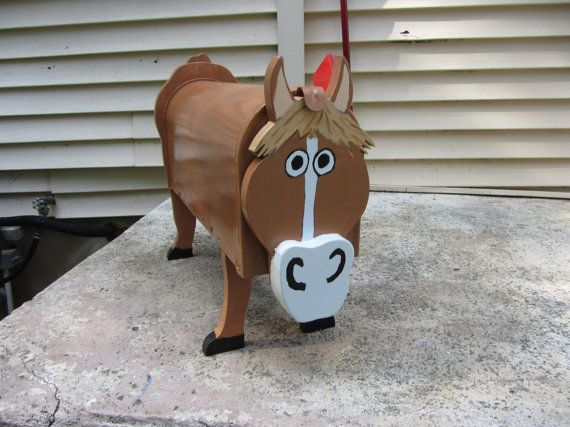 Custom functional mailbox made to look like a Horse. It is designed over a approved metal mailbox. It has a functional flag.