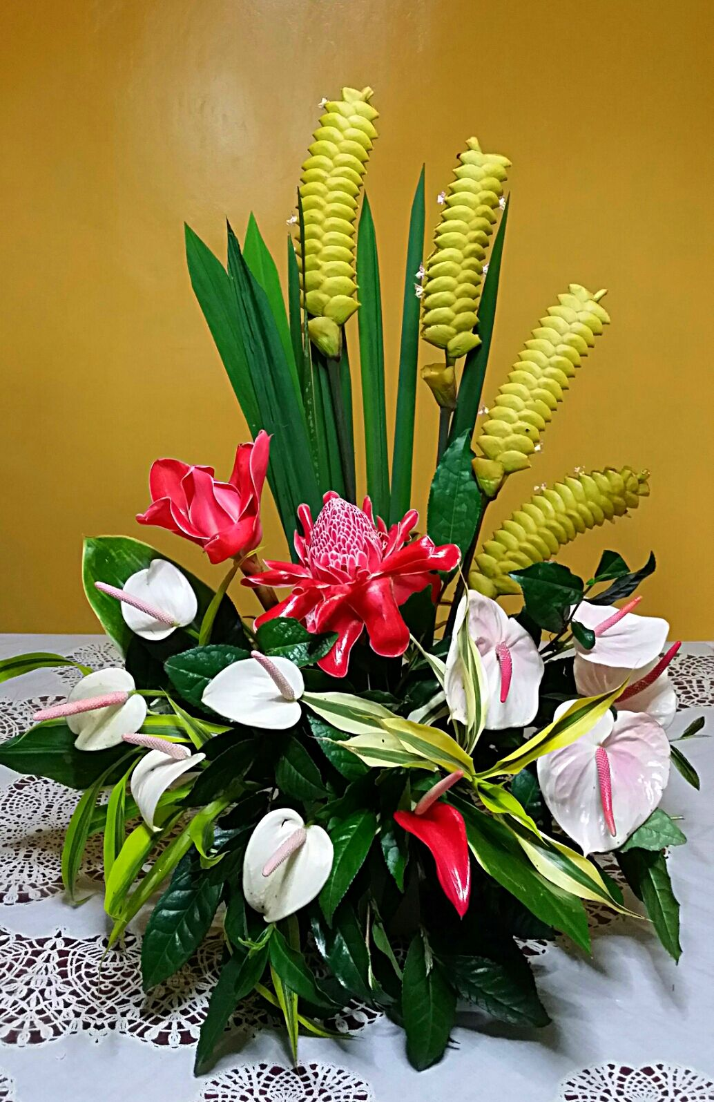 A Tropical Arrangement Using Ratthlesnake Flower White Anthuriums And Torch Ginger Flower Arrangements Ginger Flower Tropical Flower Arrangements