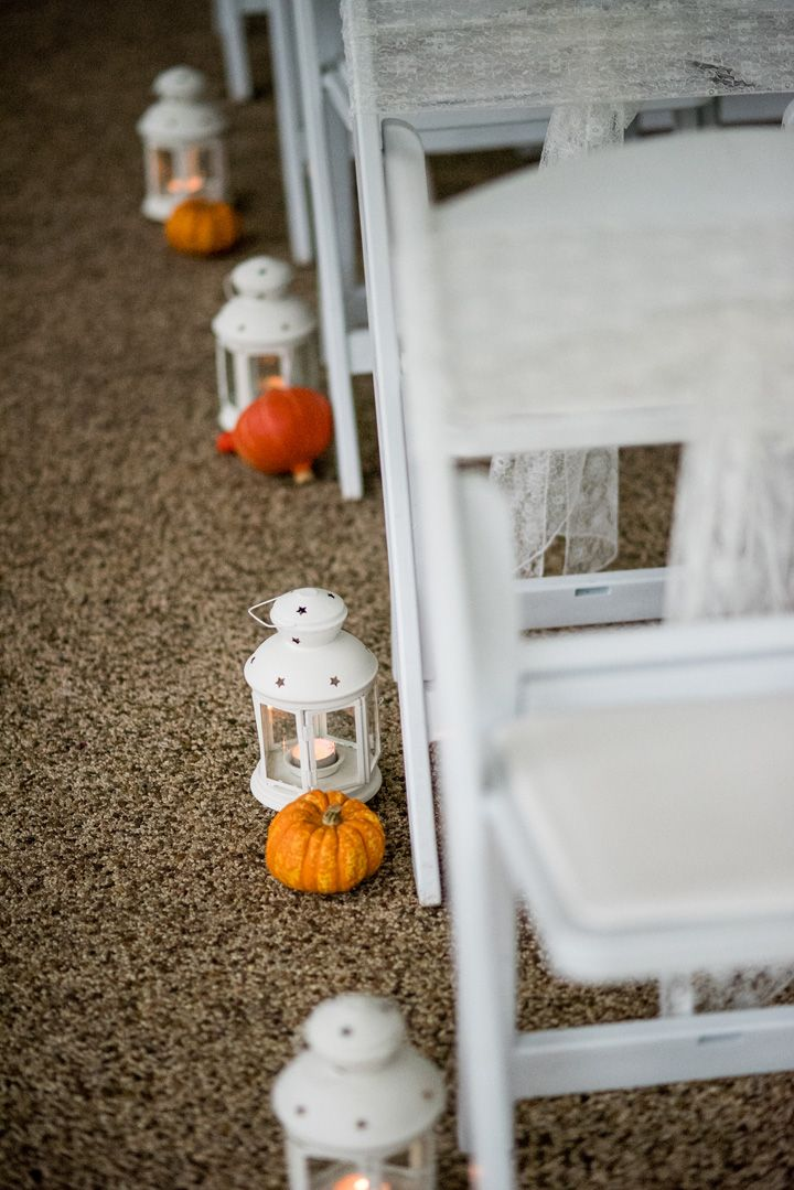 Pumpkins and mini lantern aisle decor | Halloween themed wedding aisle decorations | Autumn wedding inspiration