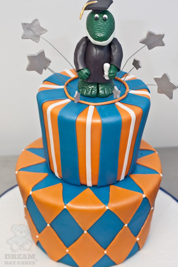 2 tiered gator graduation cake.  Like A Chance of Showers on facebook! http://www.facebook.com/chanceofshowersonline?ref=tn_tnmn