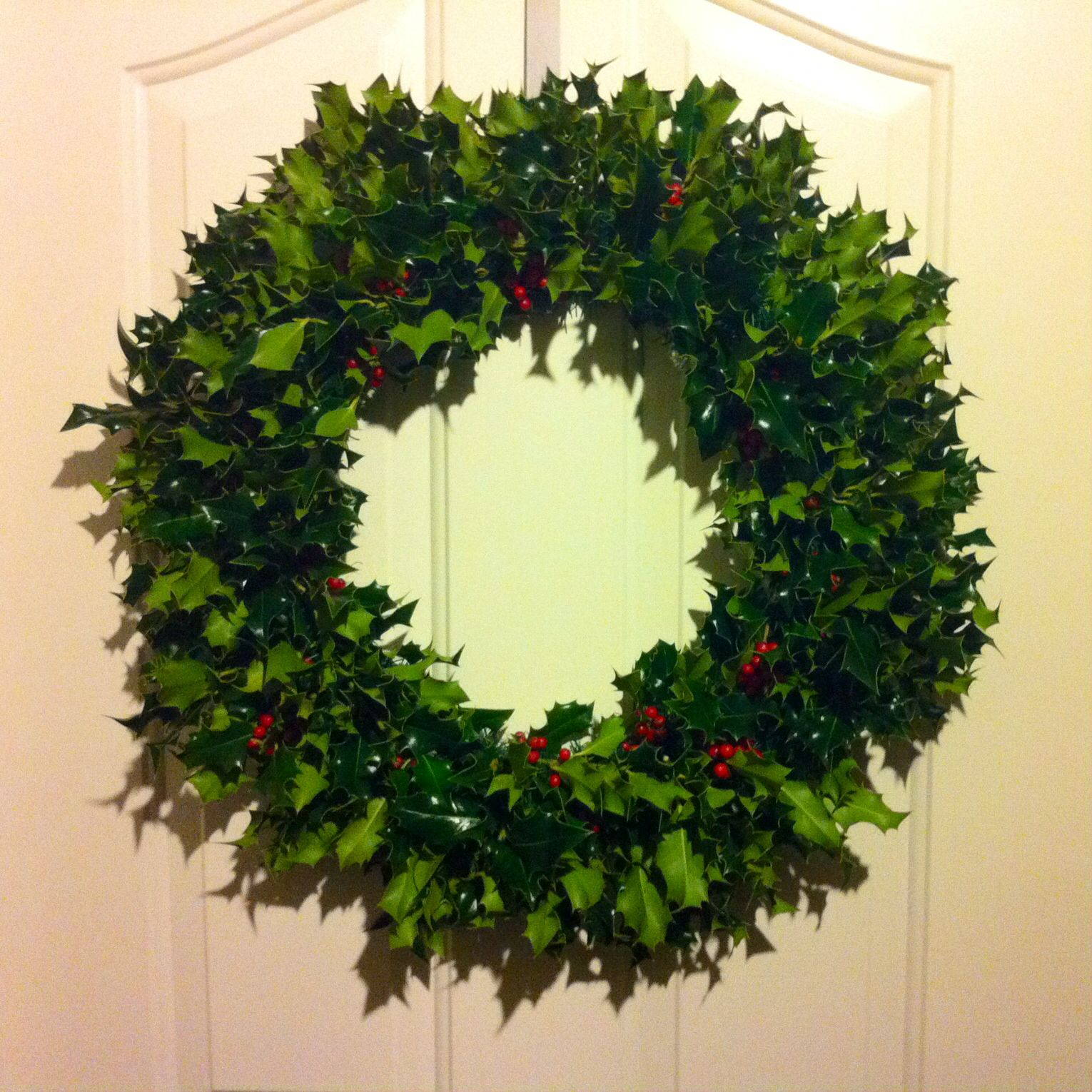 Real holly wreath. Painful DIY because it's difficult to use gloves while arranging the holly into the wire wreath. But overall I'm happy with the result!