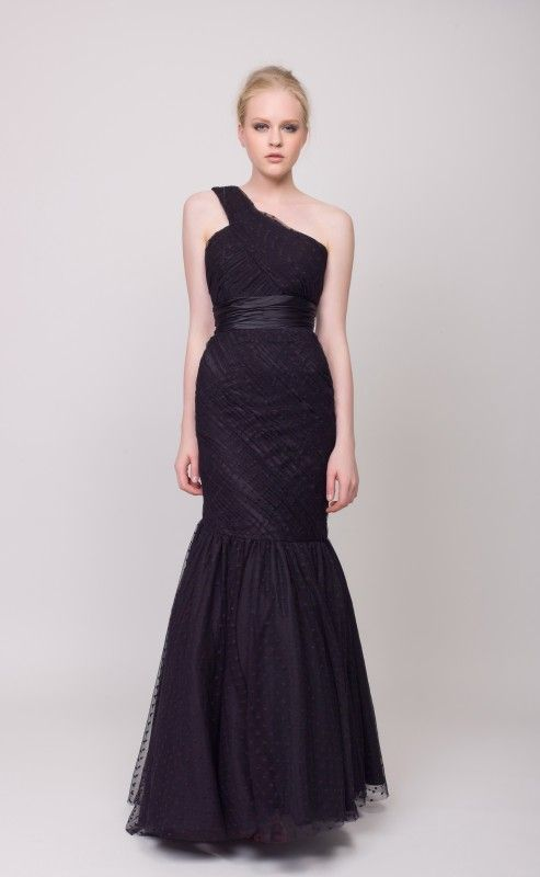 An elegant Hollywood style evening gown with an extended bodice and ...