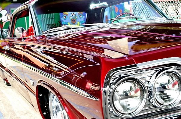 A trimmed out 64 Impala is shown at a toy drive for the San Diego Lowriders Council.