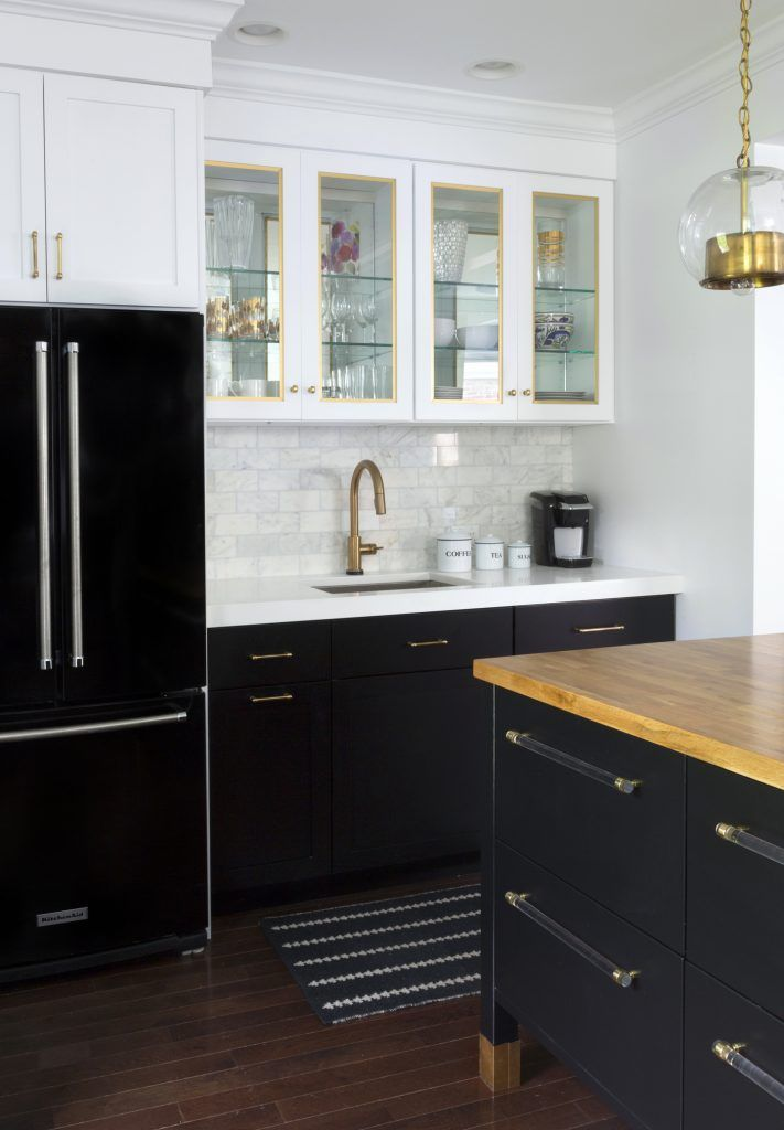 Black-refrigerator-with-black-base-cabinets-and-white-upper-cabinets ...