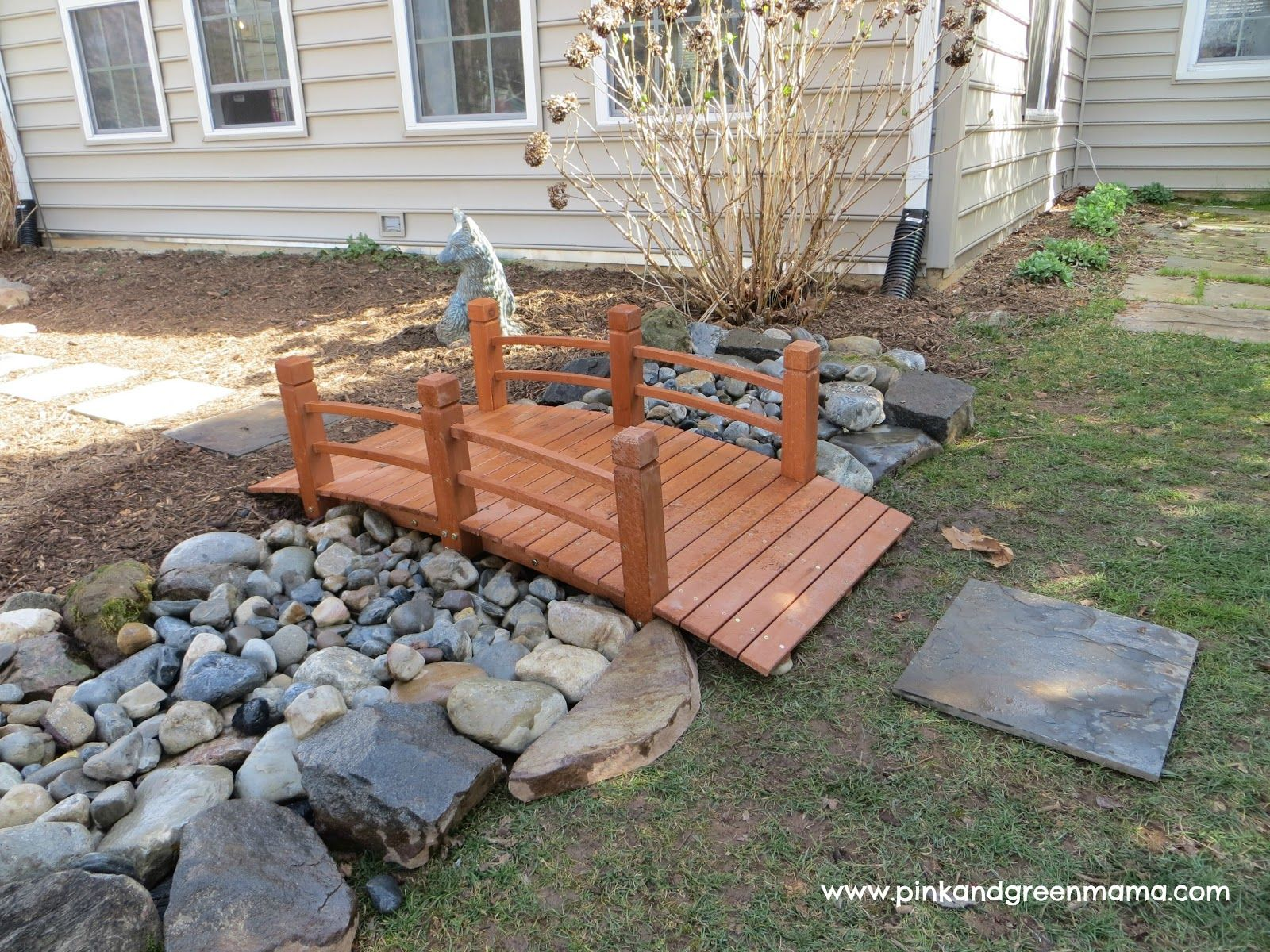 diy backyard makeover on a budget from pink and green mama blog dry river bed bridge and fun. Black Bedroom Furniture Sets. Home Design Ideas