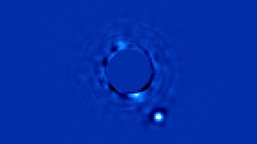 Beta Pictoris b is shown here orbiting at 8–9 AU from its star. It was directly imaged by the Gemini Planet Imager in Chile. Over 63 light-years from Earth, it is 4–11 times the mass of Jupiter, with a radius around 65% larger than Jupiter's.