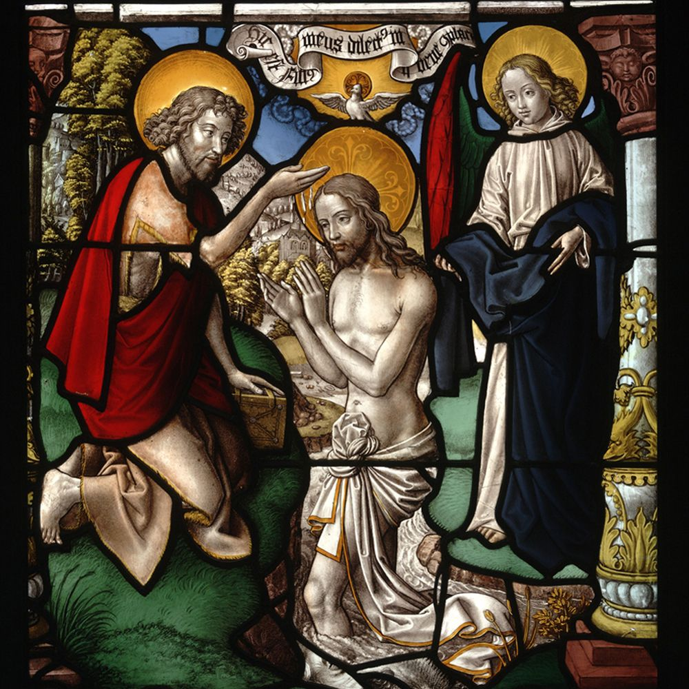 painted and stained glass depicting the baptism of christ by