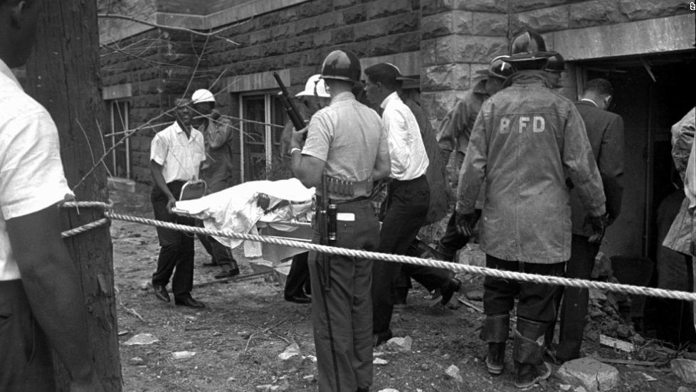 Rescue workers carry out the body of one of the victims of the 16th Street Baptist Church ...