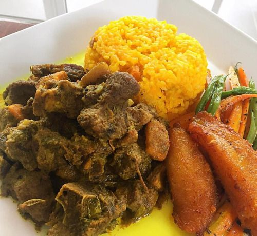 curry goat served with pumpkin rice  100 hope road