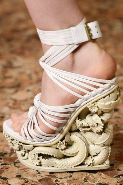 Emilio Pucci explores the delights of Asia's Orient with these amazing wedges from their spring summer 2013 collection shown at Milan Fashion Week.    Source: Gettyimages.com