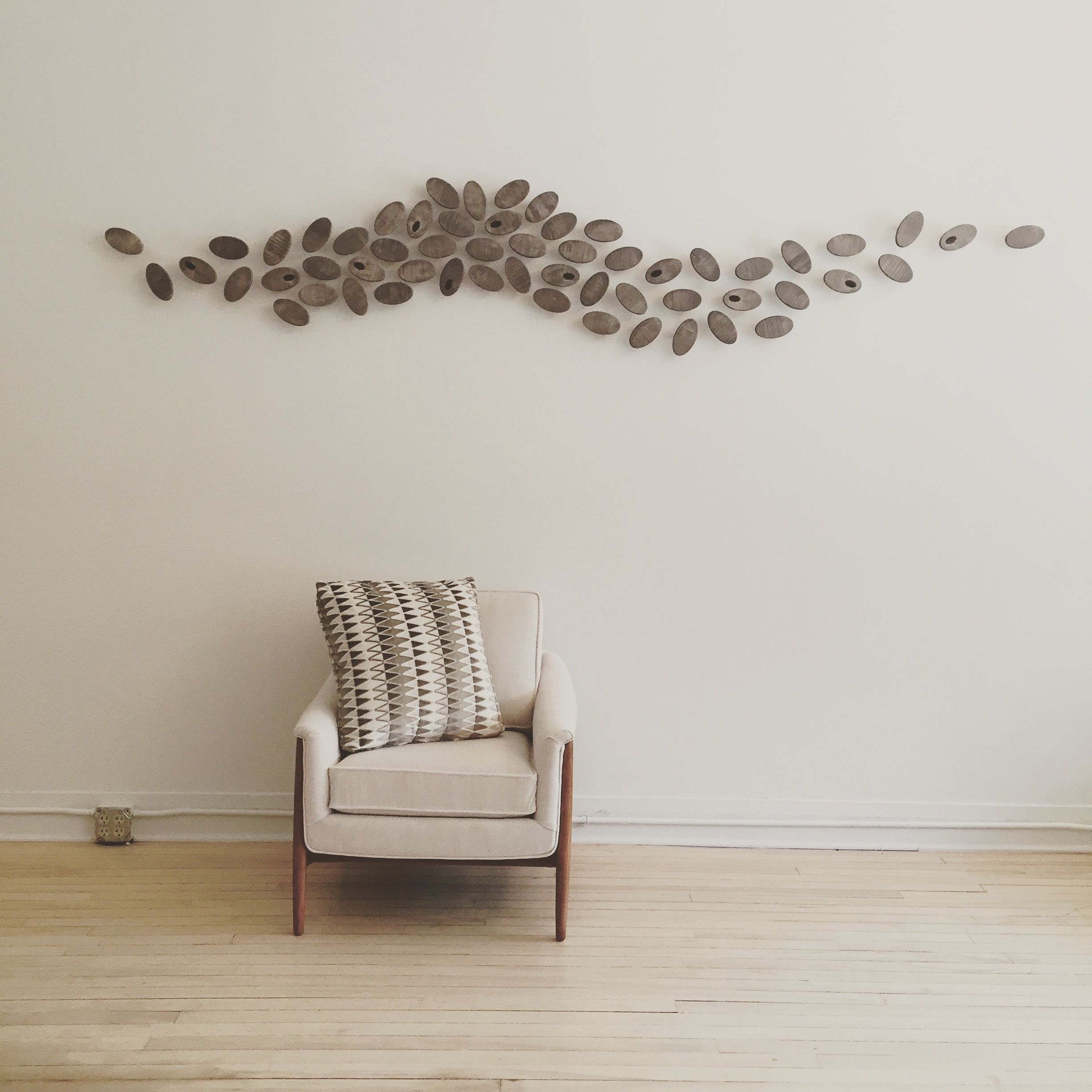 Besides their intriguing, biomimetic compositions, wall features by Susie Frazier can also have a high degree of functionality. This project features matching magnetic components so the interior designers who use it, can showcase papers or images during their business meetings. When not in use, it remains a compelling piece of art.