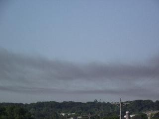 The Dark Haze Of Smoke From The Iowa City Landfill Fire Drapes