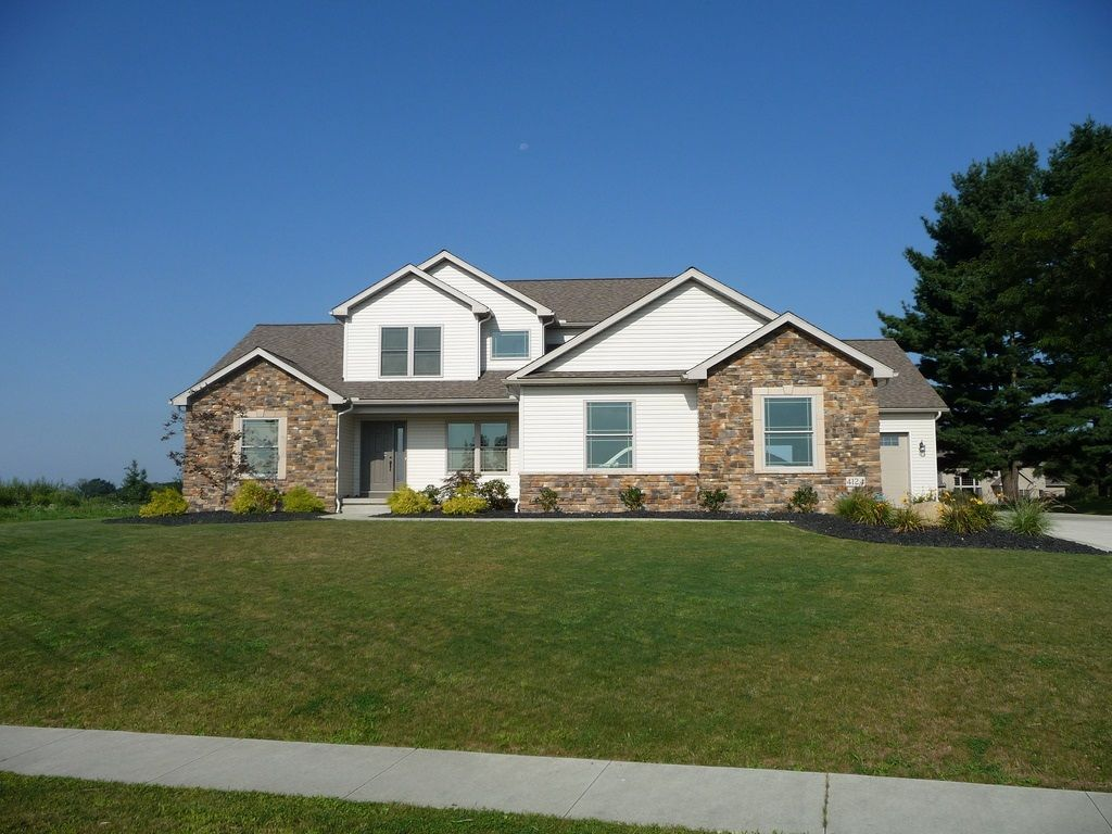 Beautiful home exterior featuring stone accenting. 4 bedroom, first floor master, 3 car garage.