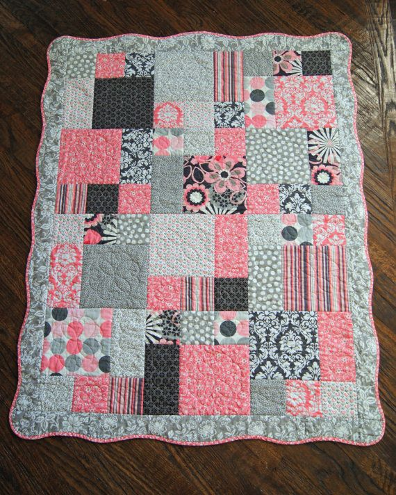 Quilt for baby girl scalloped border colors are pink gray and white