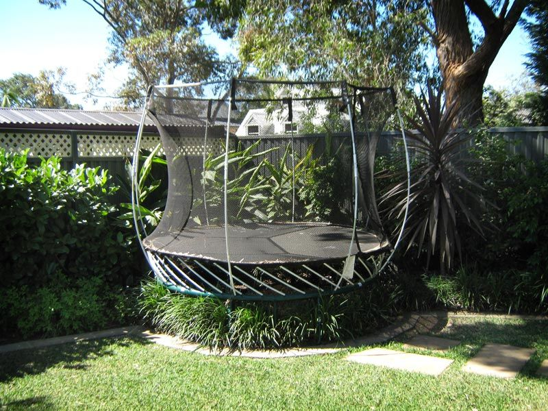 the second feature in this series of child friendly gardens explores methods to camouflage childrens trampolines so they arent so much of an eyesore - Garden Design With Trampoline