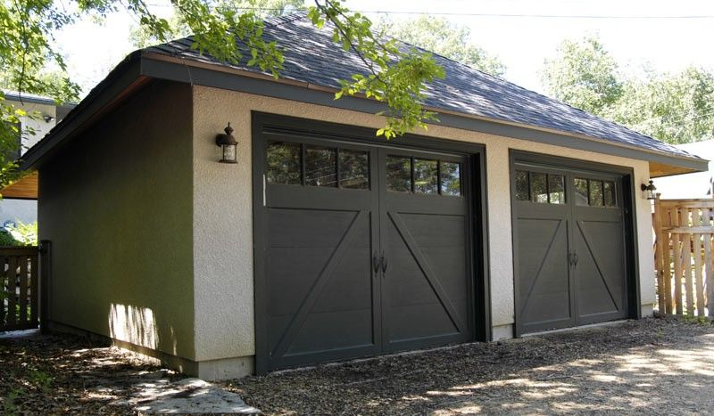 Swing out garage doors terra firma building and for Build carriage garage doors