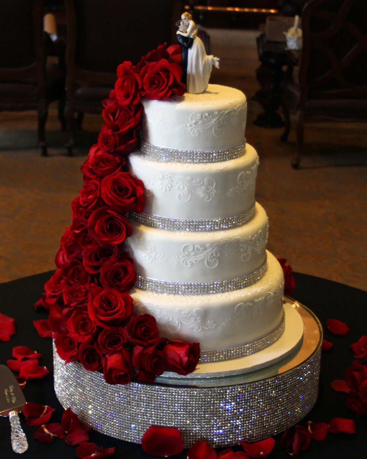 Red bling centerpieces red roses cascading from top all atop a