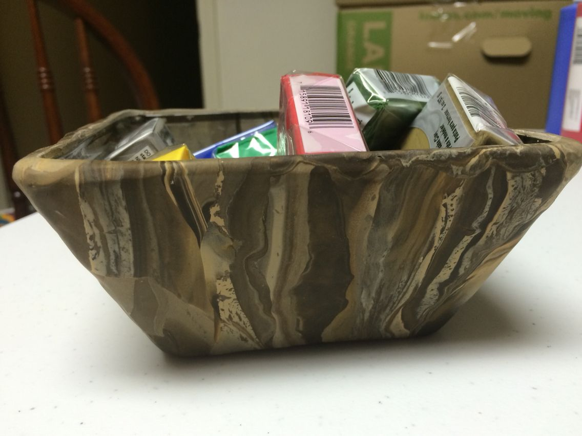 A bowl I made with blended polymer clay over a square glass bowl.