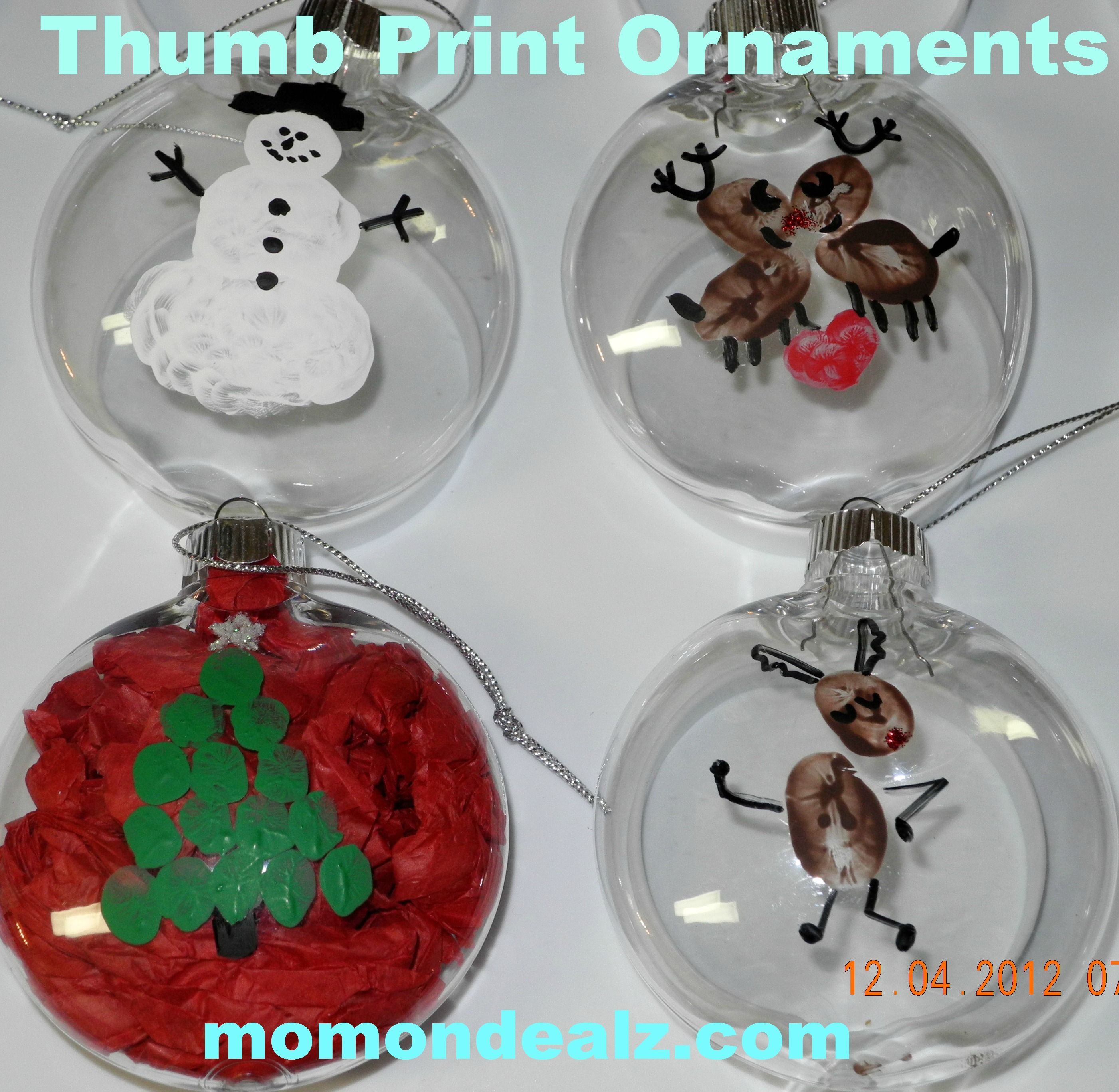 Thumb print ornaments...thinking maybe giving them a coat ...