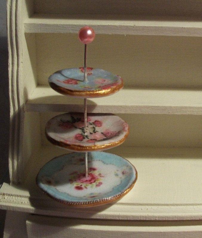 Dolls house miniature shabby chic 3 tier cake stand. £5.00, via Etsy.