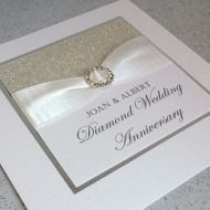 Diamond wedding anniversary card Handmade designer 60th anniversary card, with a clean and simple design. A high quality, white card base with a panel of silver glimmer paper, white ribbon and diamante buckle. You can personalise this card with any na...