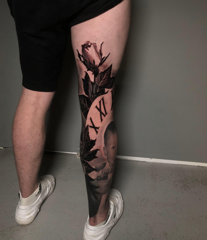 Black and grey realistic full leg tattoo in progress of a