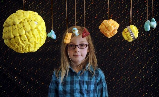 This is 8-year old Elenor Clements posing with the marshmallow bunny solar system that earned her first prize in the Peep diorama kid's category and scored her a big box of candy and Peeps.  Bonus points for still including Pluto.  #PEEPS