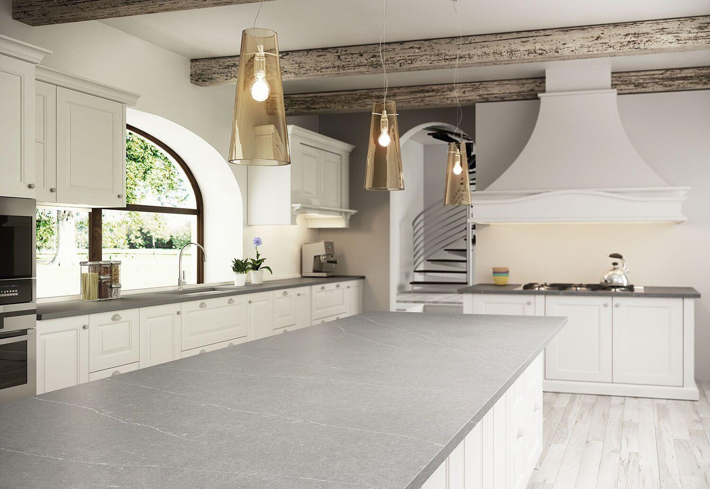 Modern kitchen with snow white quartz counter long peninsula and white - Silestone Serena Quartz Countertop In Suede Texture