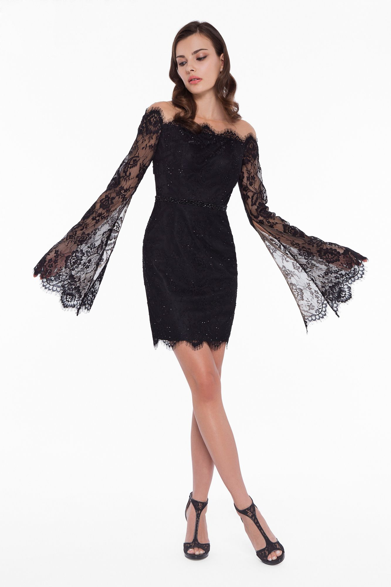 0c2010c1568 Be the crowds desire in the trendy Illusion Bateau Long Sleeve Lace Cutout Cocktail  Dress by Terani Couture. This eye-catching look features an illusion ...