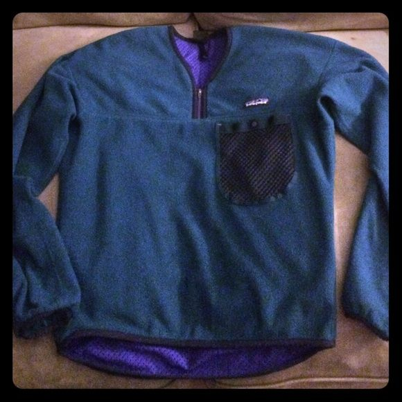 Patagonia Pullover Turquoise Patagonia pullover with pocket in front..bought from another posher, but was too small for me. The only flaw is the small rip through the inside but it is not noticeable through the outside. Also the tag through the inside is a little frayed but does not effect the good condition it's in. Patagonia Jackets & Coats