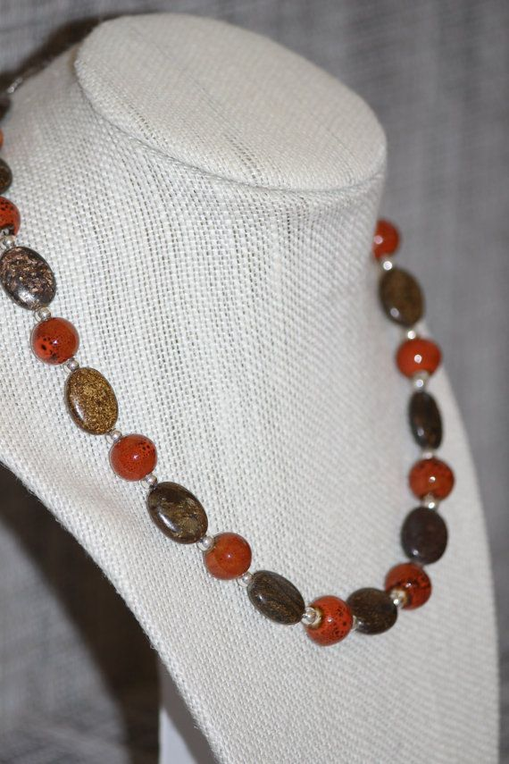 Check out this item in my Etsy shop https://www.etsy.com/listing/191589991/chunky-brown-orange-handmade-beaded