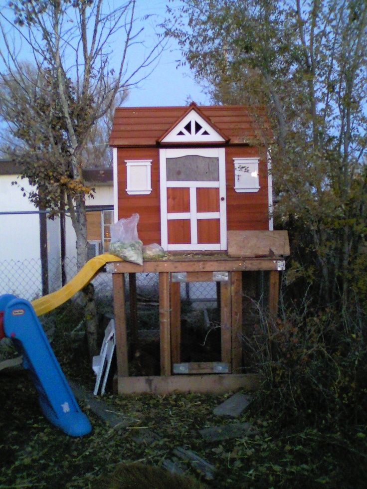 Chicken coop. A wooden playhouse built upon a 4 foot ...