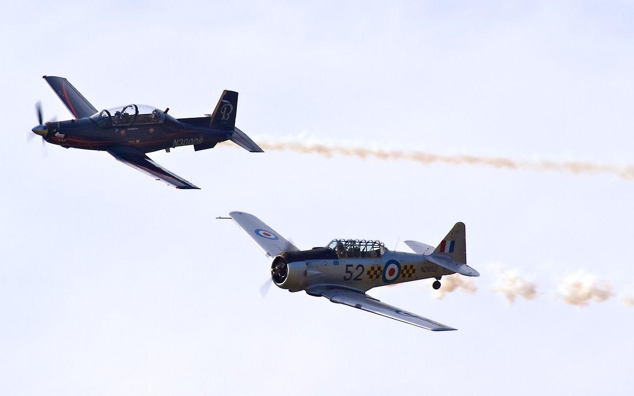 AT-6 Harvard and T-6 Texan II at Warbirds Over Wanaka 2012  Type: Raytheon 3000   North American AT-6 Harvard IIA Registration: N3000B   ZK-MJN Location: Wanaka Airport Date: 08/04/2012