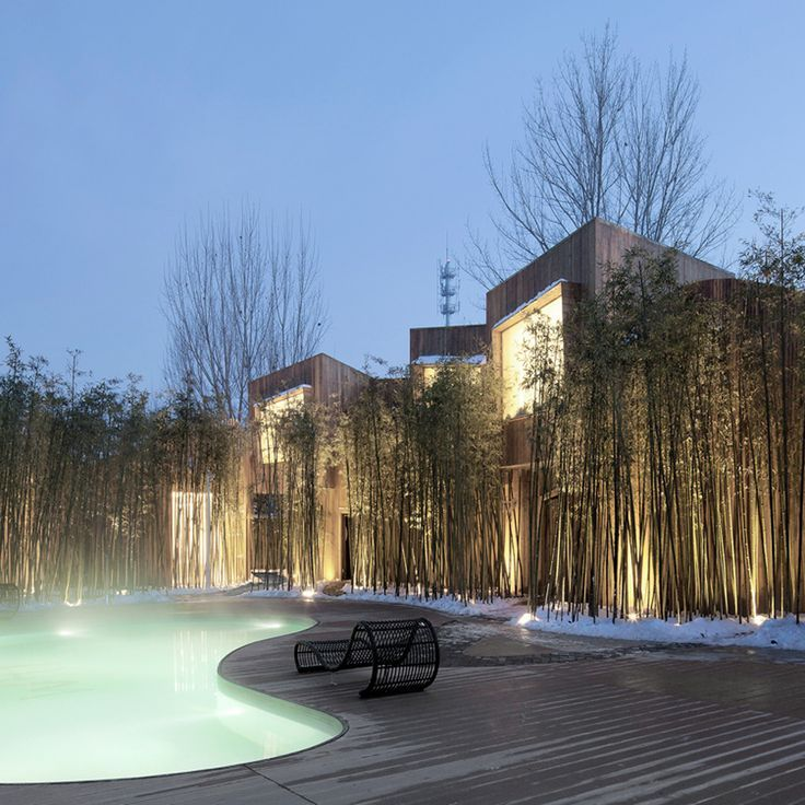 A steaming hot spring is screened behind bamboo shoots at this hotel in Beijing  landscape