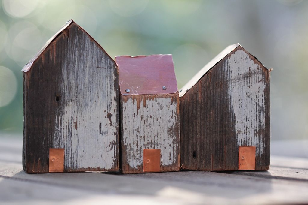 Little Houses From Recycled Timber With Copper Roofs And
