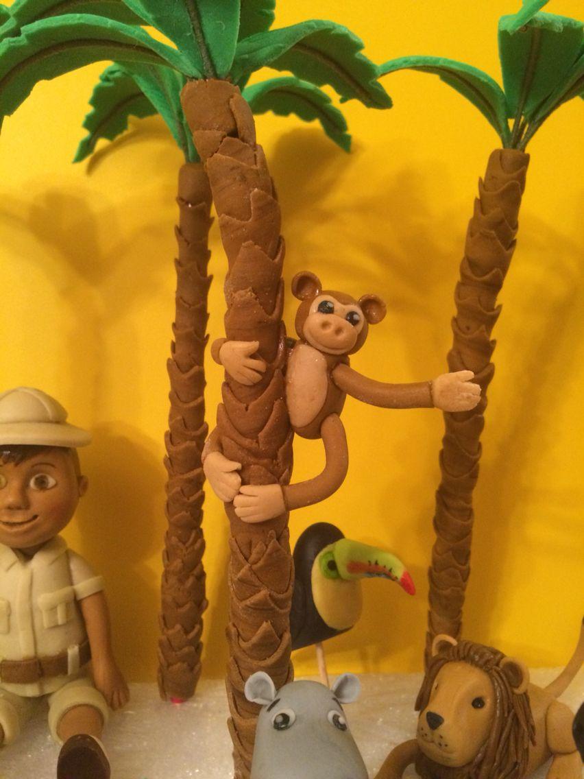 cute little fondant monkey hanging off a palm tree amazing