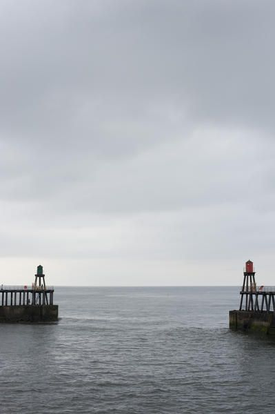 Port and starboard navigation beacons on the breakwaters or pier extensions at the entrance to Whitby harbour in Yorkshire - By stockarch.com user: photoeverywhere