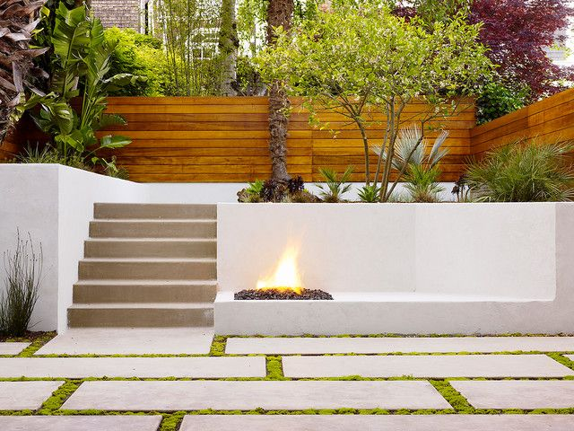 Nice Minimalist Backyard Design With Concrete Patio, Pavers And Stairs Also  Wood Slat Fence