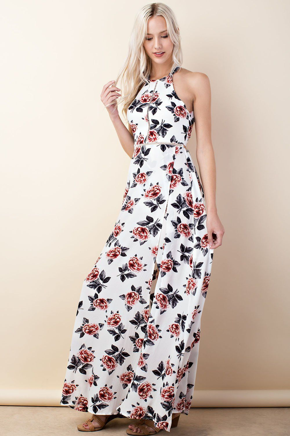 74cf7b1bd651 Flaunt your body in this beautiful Halter Neck Trim Insert Printed Maxi  Dress in Off White. It has red and white floral print with front slit.