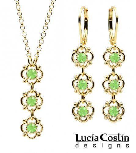 14K Yellow Gold over .925 Sterling Silver Pendant and Earrings Set Designed by Lucia Costin with 4 Petal Flowers Surrounded by Dots, Enhanced with Light Green Swarovski Crystals Lucia Costin. $79.00. Lucia Costin jewelry set. Enhanced with peridot Swarovski crystals. Unique and feminine, perfect to wear for special occasions and evenings. Create a delicate and romantic look. Produced delicately by hand, made in USA