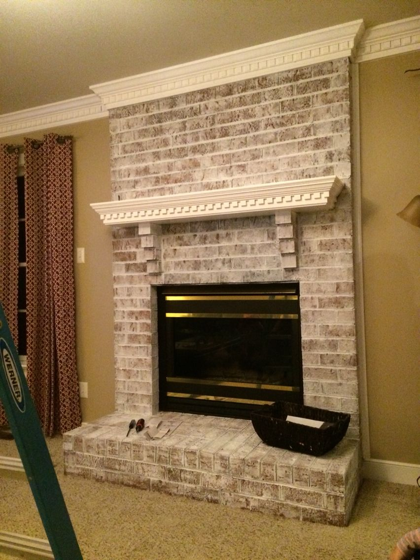 Whitewash fireplace and painted trim project