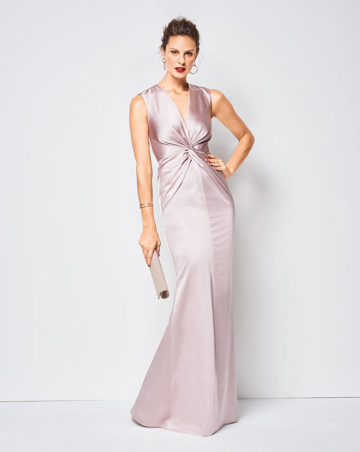 Kleider in extravagantem Stil mit raffinierter Verschlingung im ...