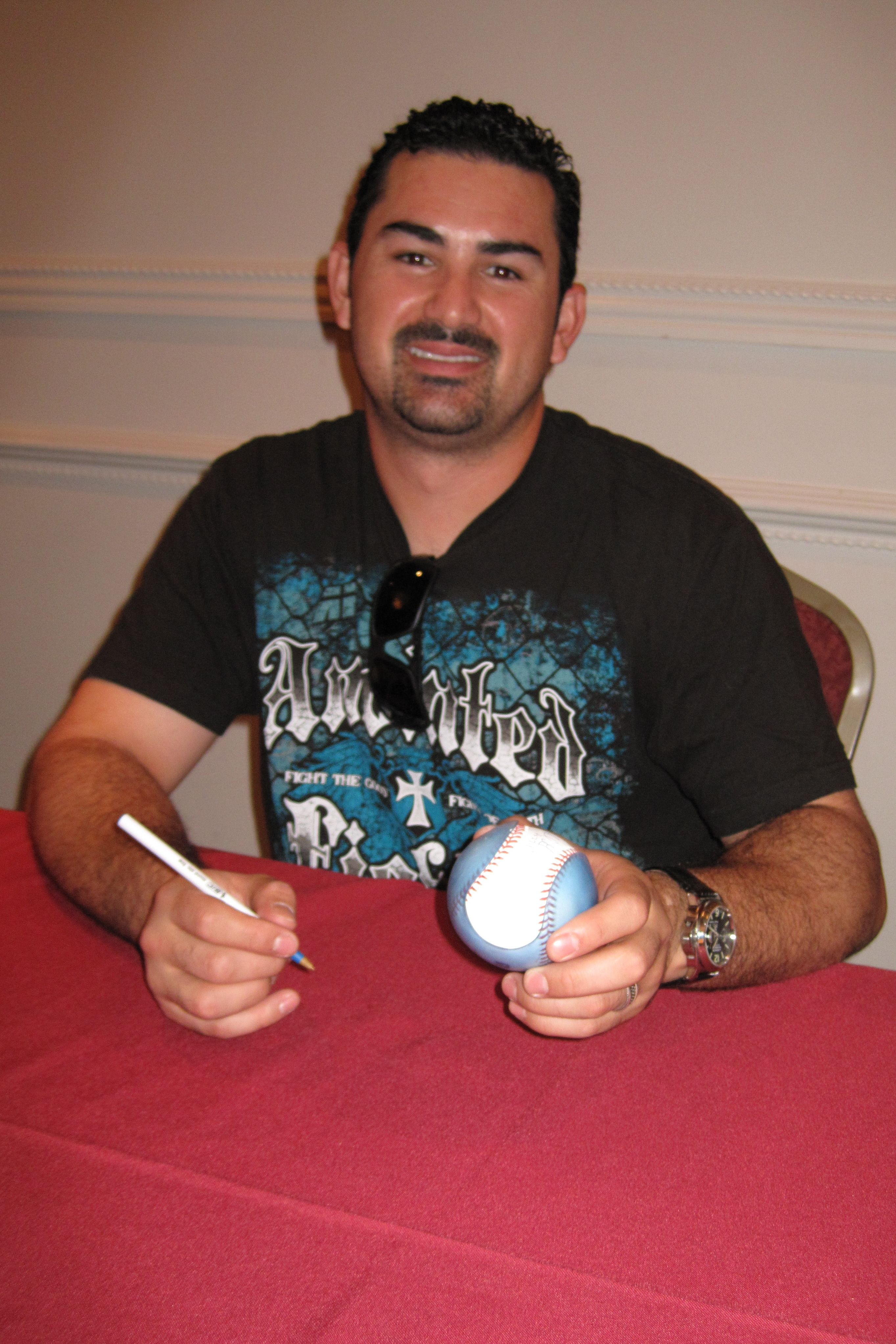 Adrian Gonzalez holding a more modern prototype Sweetspot Jacket  7/9/2011 in Randolph, Mass
