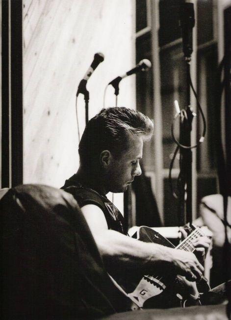 U2start.com | Photos | Larry Playing Guitar