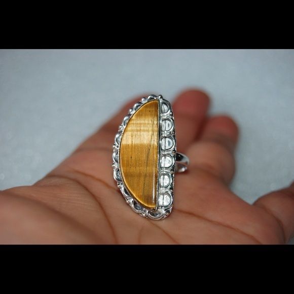 """✂️SALE✂️Crescent Tiger Eye 925 Silver Ring Size 9 Pretty tiger eye ring size 9,silver is stamped 925.All my items are polished and clean.Please note that the photos are enlarge slightly for your convenience so make sure to notice the actual measurements of the item on the """"product description"""" as it maybe smaller than the representing photo. Colors of the stone also may be slightly vary than the pictures due to light.These are all handmade items in my closet so please do not expect…"""